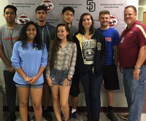 MSD national merit scholars are congratulated by Principal Ty Thompson. Photo courtesy of Ty Thompson