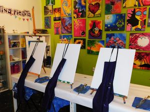Customers enjoy guided painting lessons