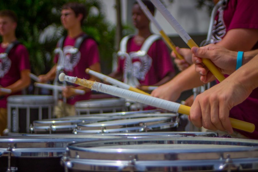 %28Photo+Gallery%29+Drum+line+and+color+guard+give+pre-game+performance+to+boost+spirit