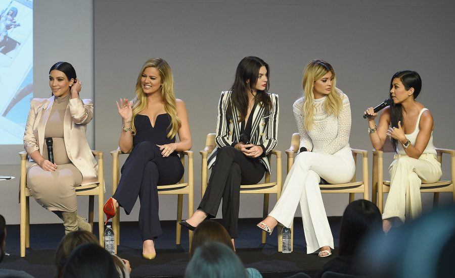 Kardashian sisters discussing their apps at the Apple launch in Soho.