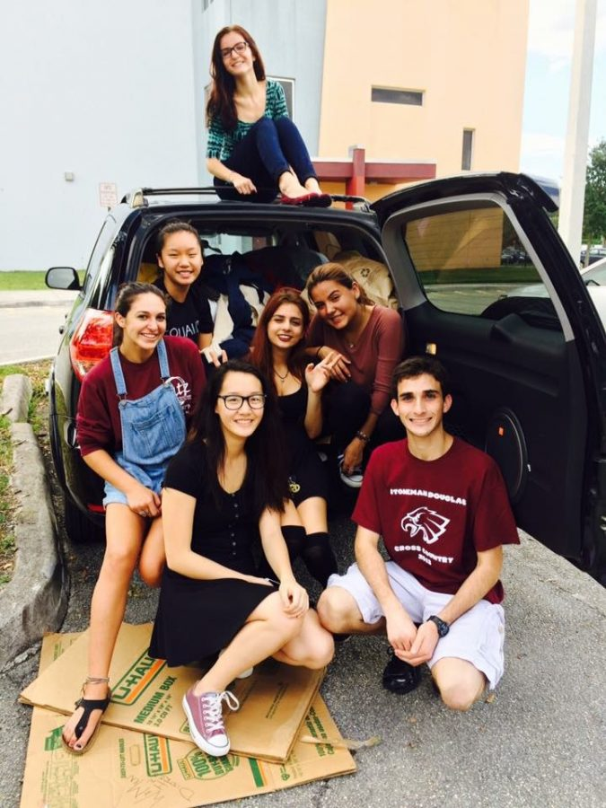 (From left to right) Morgan Schreiber, Kathy Liu, Joanna Zhuang, Jessie Sinitch, Sam Maldonado, Keila Velasquez, and Kathy Liu fill three cars with clothing donations.