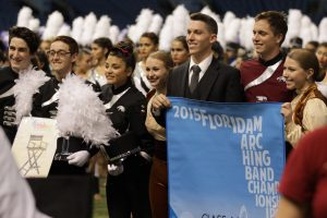 The MSD Eagle Regiment celebrates winning second place after their performance. Photo by Liam Hutton.