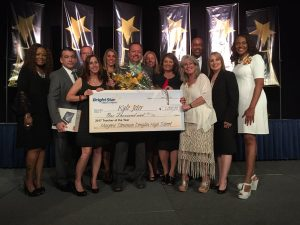 Jeter accepts cash prize of $1,000, the monetary award for being named Broward County Teacher of the Year.