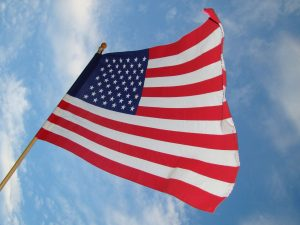 The American flag flies in the sky.