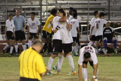 Senior captains Casey Conn and Felipe Mendes embrace after their season-opening 2-1 victory against rival Boca Raton. (Photo Courtesy of Casey Conn)