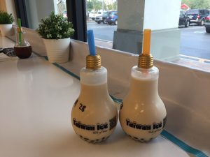 Two jasmine milk teas with boba in lightbulb bottles give a creative look to the desserts at Taiwan Ice. Photo by Christy Ma