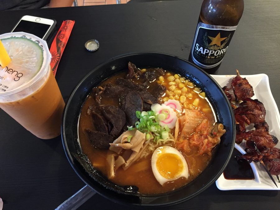 From left to right there is the large Thai boba tea, spicy kimchi beef ramen and octopus skewers that I had for lunch. Photo by Christy Ma