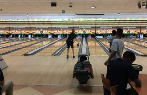 Senior Devon Weisenfeld looks on as he bowls for a strike. Photo courtesy of Richard Doan