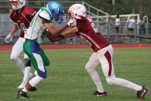 Defender Tyler Abbondanza (28) blocks a player from Coral Spring High School at a football game on Sept. 27. Photo by Lyliah Skinner