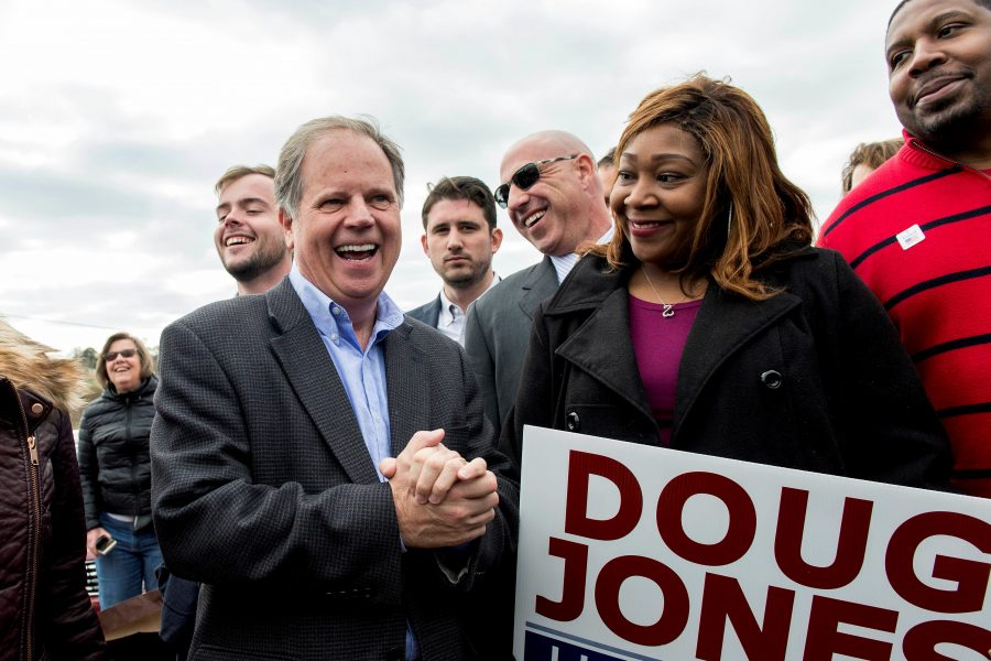 Doug Jones, Democratic candidate for the U.S. Senate seat in Alabama, greets supporters outside the Bethel Baptist Church on election day, Tuesday, Dec. 12, 2017. (Brian Cahn/Zuma Press/TNS)