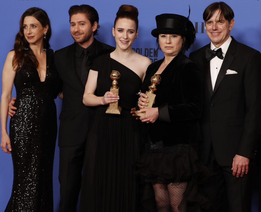 From left, Marin Hinkle, Michael Zegen, Rachel Brosnahan, Amy Sherman-Palladino, Daniel Palladino, and Tony Shalhoub backstage at the 75th Annual Golden Globes at the Beverly Hilton Hotel in Beverly Hills, Calif., on Sunday, Jan. 7, 2018. (Allen J. Schaben/Los Angeles Times/TNS)