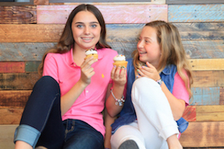 Gwyneth Bishara and Ella Bishara hold cupcakes to represent Gwyneth's organization, Cupcakes for Charity. Photo courtesy of Evelyn Robles, Lifestyle Media Group