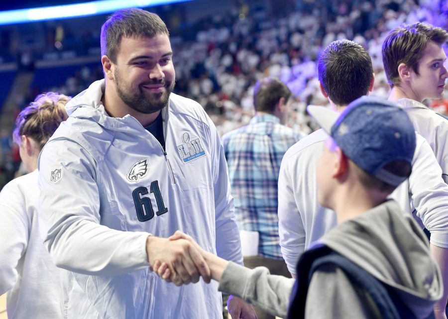 Penn State football letterman and Philadelphia Eagles Super Bowl champion Stefen Wisniewski greets fans before the Penn State men's basketball game against Ohio State on Thursday, February 15, 2018, at the Bryce Jordan Center in University Park, Pa. The host Nittany Lions won, 79-56. (Abby Drey/Centre Daily Times/TNS)