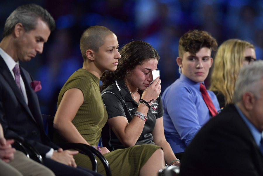 Marjory Stoneman Douglas High School student Emma Gonzalez comforts a classmate during a CNN town hall meeting on Wednesday, Feb. 21, 2018, at the BB&T Center, in Sunrise, Fla. Photo courtesy of Michael Laughlin, Sun Sentinel, Tribune News Service