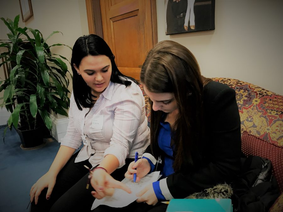 Sophomore Dara Rosen and junior Rebecca Schneid jot down potential questions for Sen. Bernie Sanders outside his office in Washington, D.C. Photo by Melissa Falkowski.