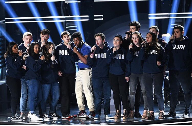 """MSD students perform """"Youth"""" on stage at the BBMAS with Shawn Mendes and Khalid. Photo by Melody Hertzfeld."""