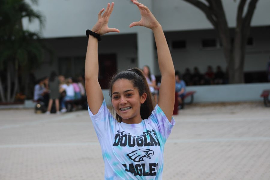 Junior Juliette Hoffiz practices yoga in the courtyard during lunch