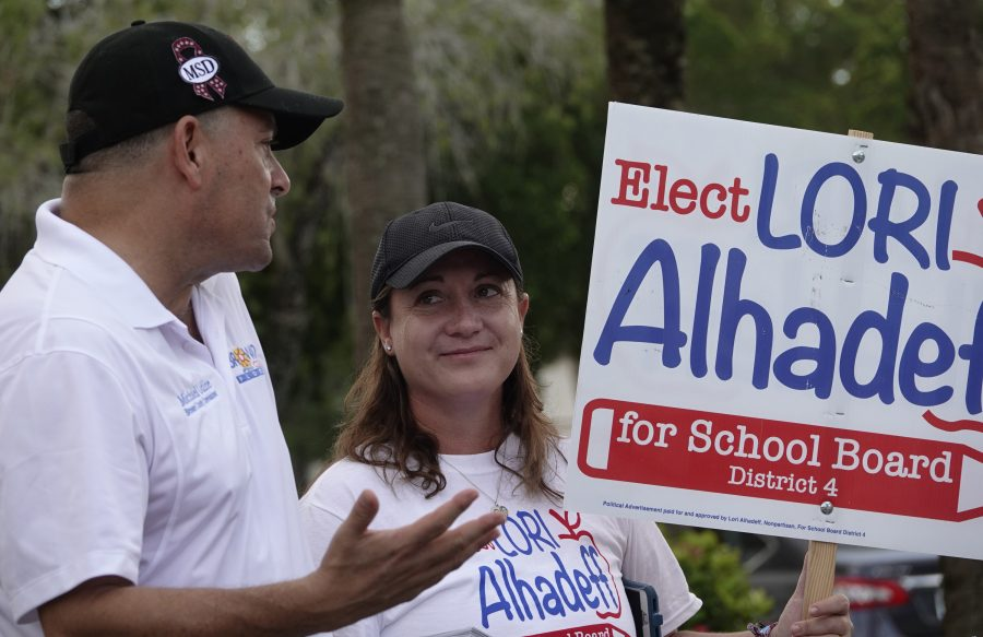 Lori Alhadeff speaks County Commissioner Michael Udine at a polling place in Tamarac, Fla., Tuesday, Aug. 28, 2018. Alhadeff has become a forceful advocate for gun control and school safety. (Joe Cavaretta/South Florida Sun Sentinel/TNS)