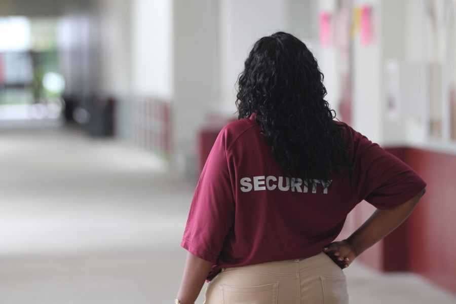 Patrolling the Halls. Security team member Teresa Williams patrols the halls while class is in session. Photo by Nyan Clarke