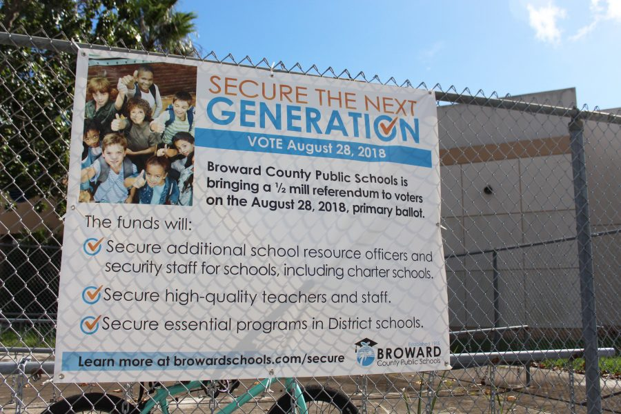 Persuasive Poster. A sign advertising the benefits of the Secure the Next Generation Referendum hangs in the bus loop at Country Hills Elementary. Photo by Nyan Clarke