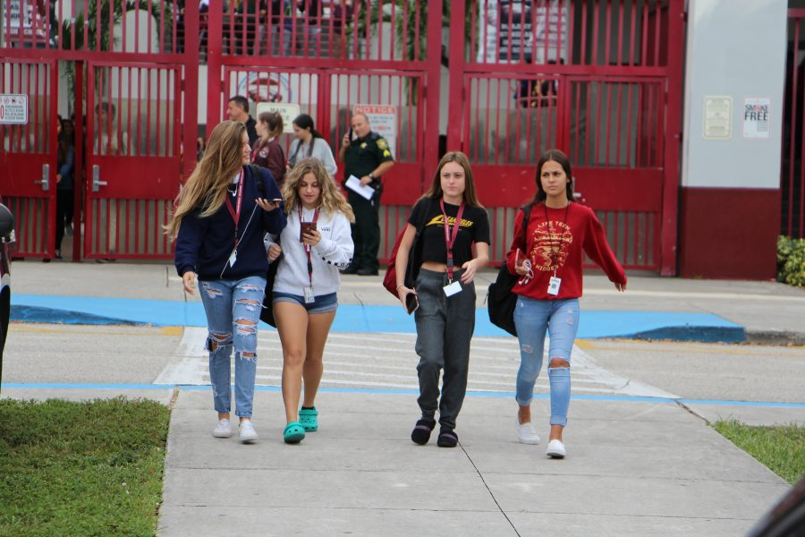 Freshmen Kelly Cooke, Carli Komroff, Alex Heller and Sofia Cardona walk out of school on Tuesday, Nov. 27 to protest the recent administrative changes. Photo by Dara Rosen