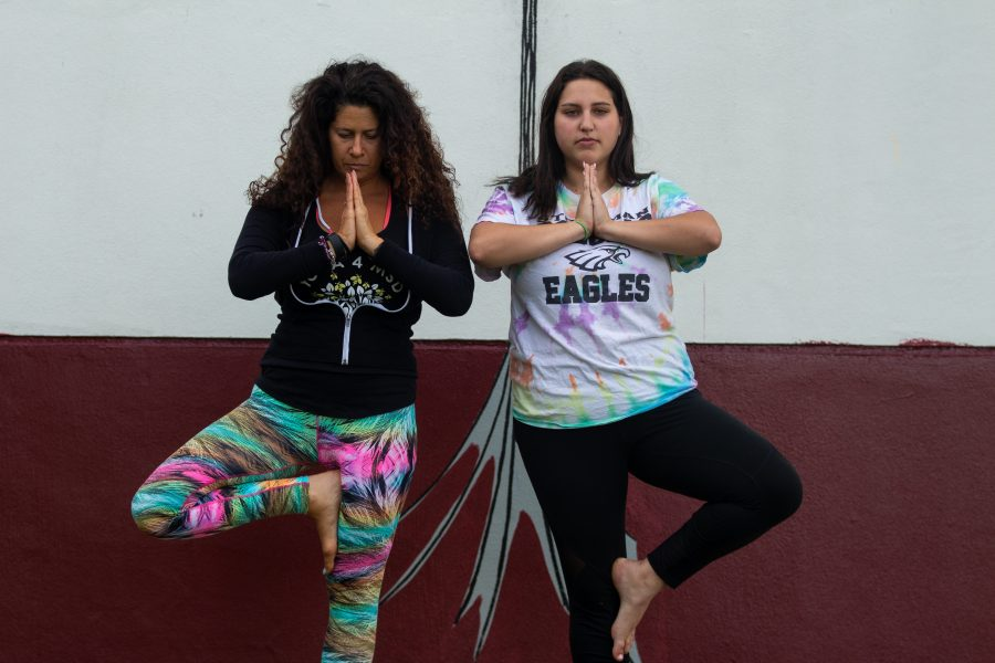 Hayley Siegel and Amy Kenny relax through yoga.
