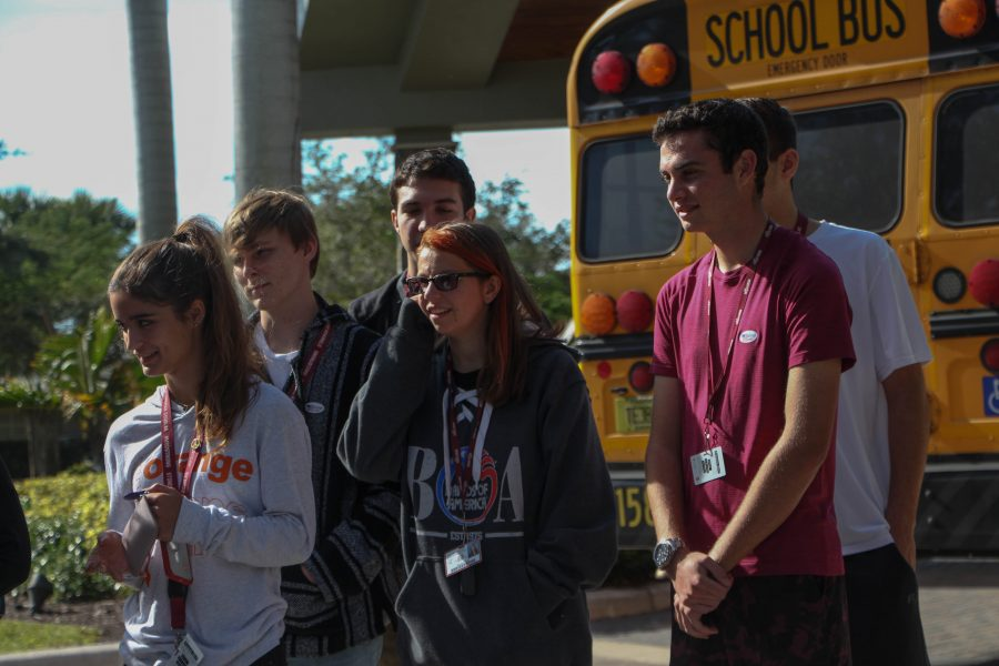 Seniors+Jessica+Frengut%2C+Maddy+King%2C+Nathan+Louis%2C+Erich+Cook+and+Michael+Robb+check+in+to+vote+at+the+Parkland+Recreational+Center+on+Thursday%2C+Nov.+1.+Eligible+seniors+were++transported+to+the+polls+to+vote+for+the+first+time+as+part+of+a+Broward+County+Public+Schools+initiative+to+engage+young+voters.+Photo+by+Rebecca+Schneid