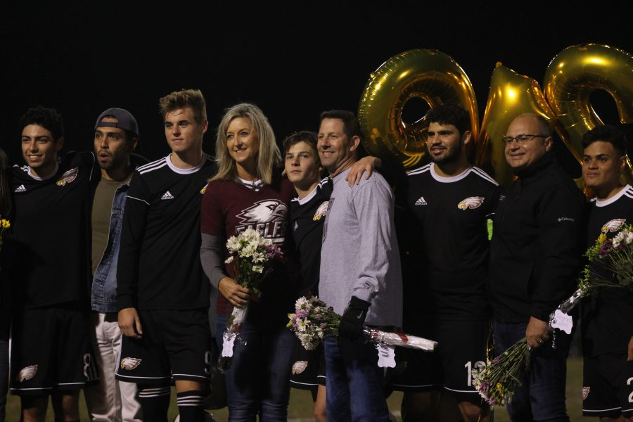 From left to right: Full-back Bryan Herrera (8), midfielder Cole Leonardi (9), striker Justin Brod (7), defense Lucas Magalhaes (12), and midfielder Juan Munera (21) pose for a senior night photo with their parents.