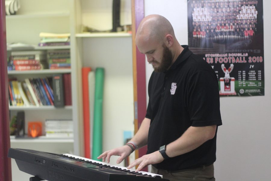 Mr. Schaller has a piano in his classroom to link his love of music with his passion for teaching. Photo by Darian Williams