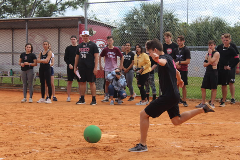 Nathan Kavanaugh kicks for the student team on March 7 at the FEA hosted student vs. faculty event. Photo by Katrina White