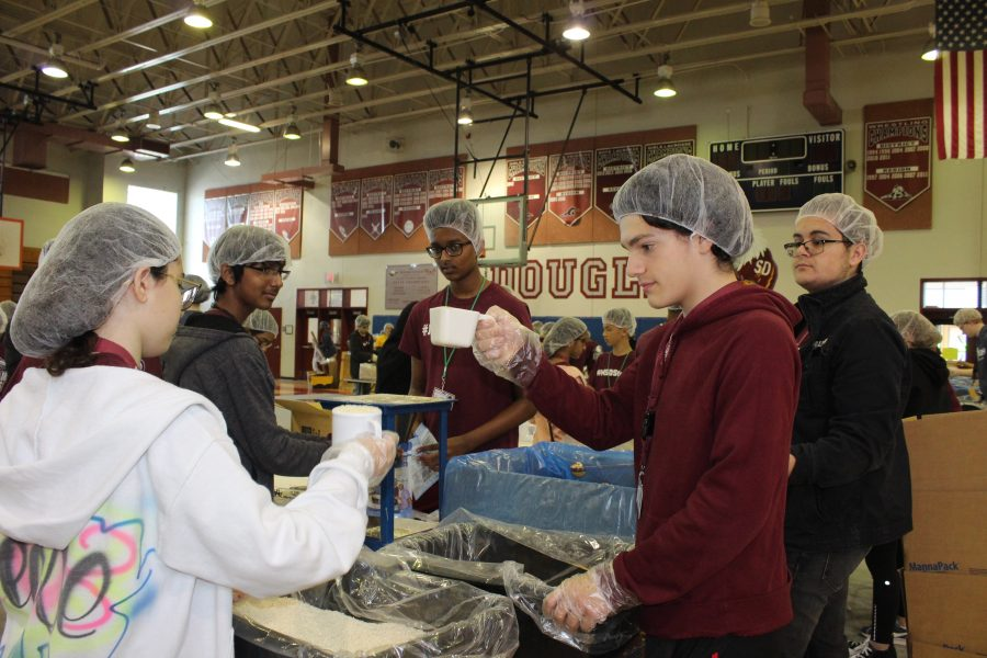 Helping Hands. MSD sophomore Lucca Santos participates in Feed My Starving Children event on Feb. 14, 2019 at Marjory Stoneman Douglas High School. Photo by Hannah Kapoor