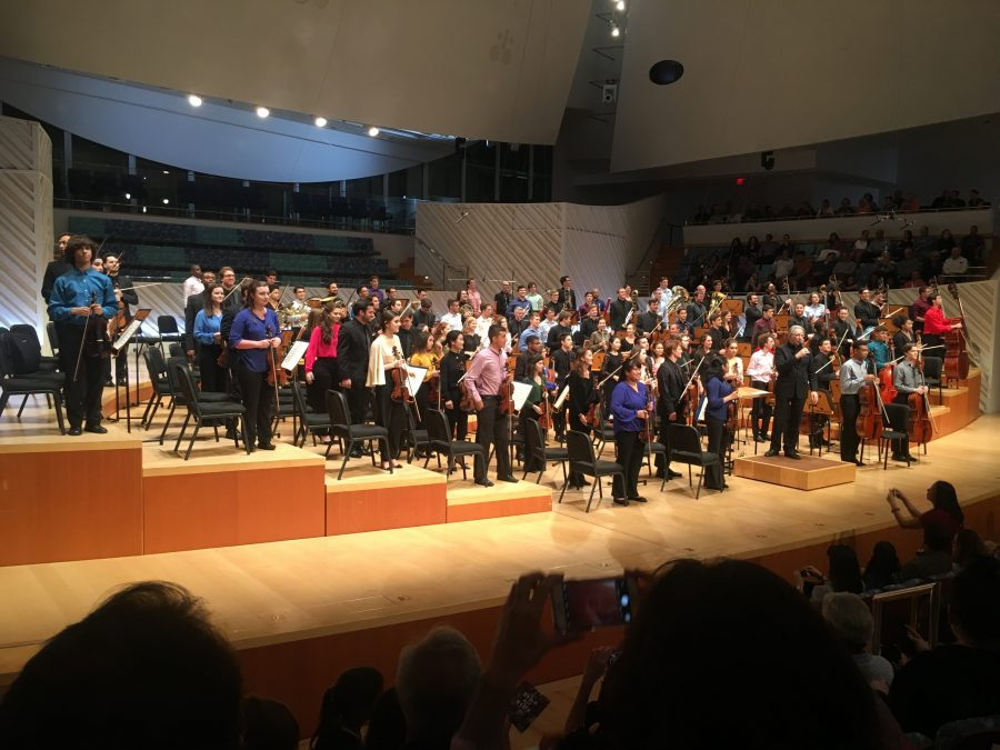 Student musicians perform with the New World Symphony at the Side-by-Side Ensemble concert.
