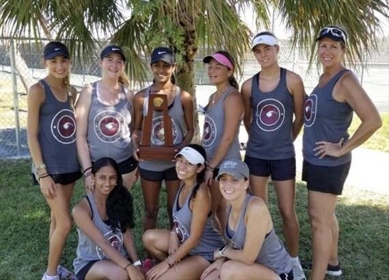 Womens varsity tennis team defeats St. Thomas Aquinas School at district tournament