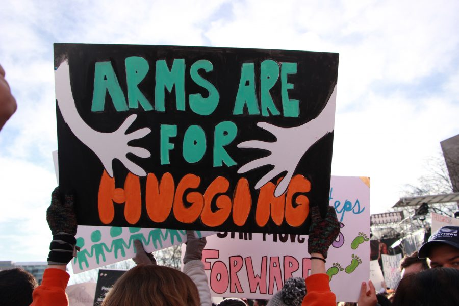 Arms for Hugging. Students protest gun violence at March for Our Lives in Washington, D.C. on March 24, 2018. Photo by Emma Dowd