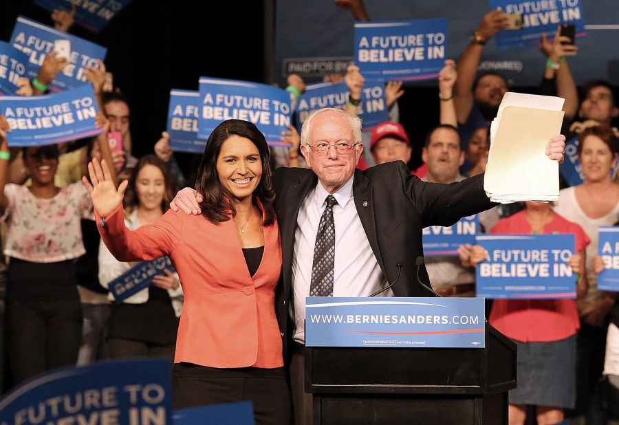 Tulsi Gabbard, left, with Sen. Bernie Sanders during the 2016 Democratic presidential campaign. Now a presidential candidate for the 2020 presidency, Gabbard spoke out against a $69-million deal to let United Airlines put its name on the Los Angeles Memorial Coliseum. (Pedro Portal/El Nuevo Herald/TNS)