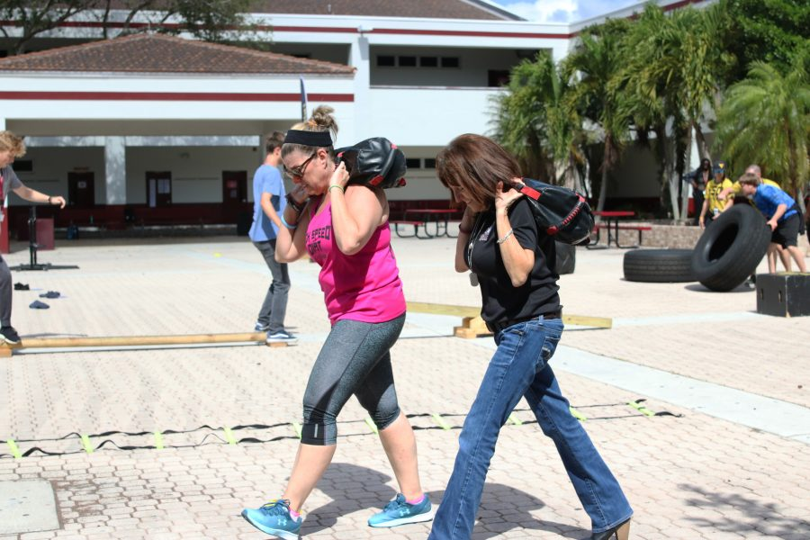 Cross-fit Course. Environmental science teacher Tammy Orilio and Spanish teacher Alicia Blonde participate in lunchtime activities on Feb. 15. Photo courtesy of Eric Garner