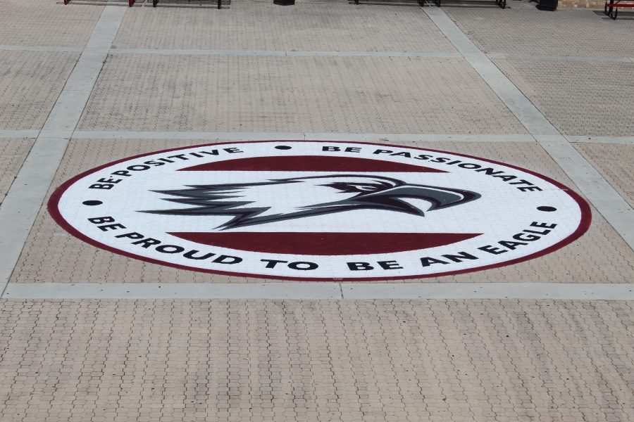"""Saying Goodbye. The class of 2019 had an emblem of the eagle logo that reads """"Be Positive, Be Passionate, Be Proud to be an Eagle"""" painted in the courtyard as their gift to the school. It is an MSD tradition for the graduating class to donate a personalized gift to beautify the campus. Photo courtesy of Dawson Corea"""