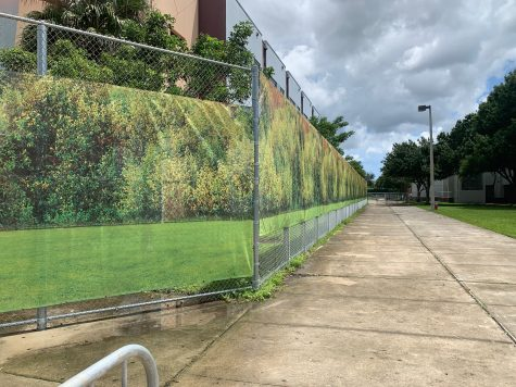 Installed in August 2019, a new banner depicting a calming forest scene surrounds the 1200 building. Following the Feb. 14, 2018 shooting at Marjory Stoneman Douglas High School that killed 17 students and staff members and injured another 17, the building has been designated a crime scene and is in the custody of the state attorneys office. The building is still being reported as usable classroom space on the Florida Inventory of School Houses report for MSD.