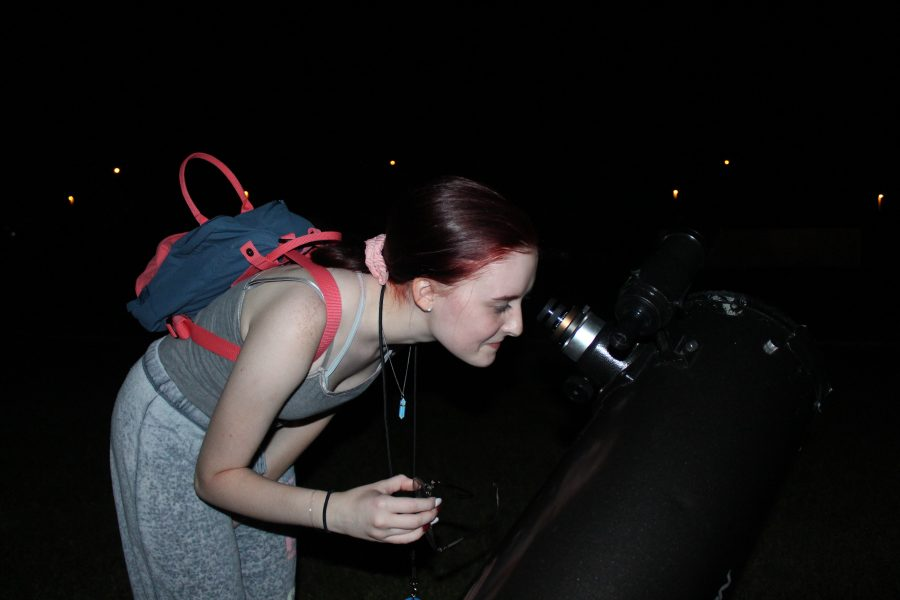 Sophomore Deanna O'Connell observes the stars and planets using one of Jeter's various telescopes.