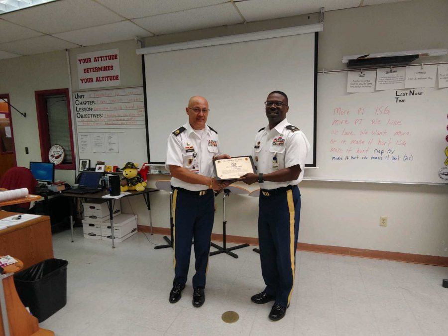 Colonel Kenneth P. Green presents Ramon Arias with the Silver Instructor Award certificate. Photo courtesy of Anna Koltunova