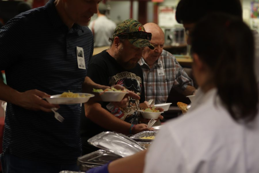 MSD staff serves lunch to the veterans who came for the annual Veteran Luncheon with their MSD student relatives.