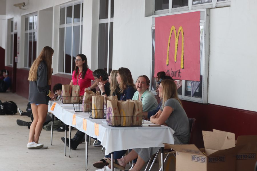 Guidance Director Veronica Ziccardi and her department hands out McDonalds meals to students who received Straight A's first quarter on Friday, Nov. 8. Photo by Darian Williams