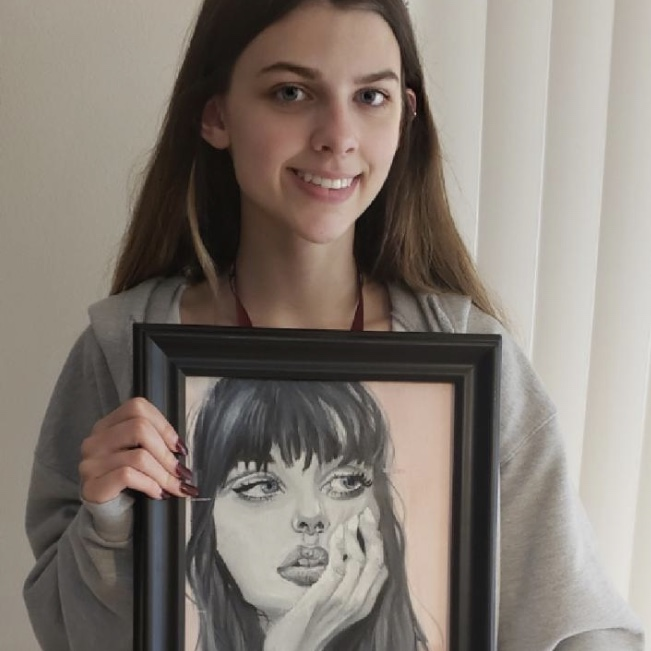 Sophomore Faith Hartwig shows off the portrait she won with at the Broward All Stars Exhibition. Photo courtesy of Faith Hartwig