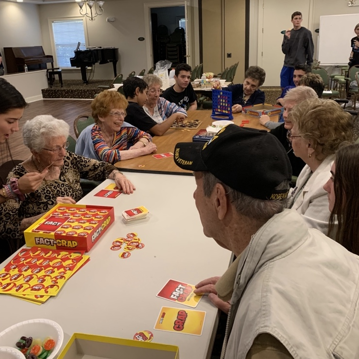 DECA students and Aston Gardens residents participate in games for their chapter project