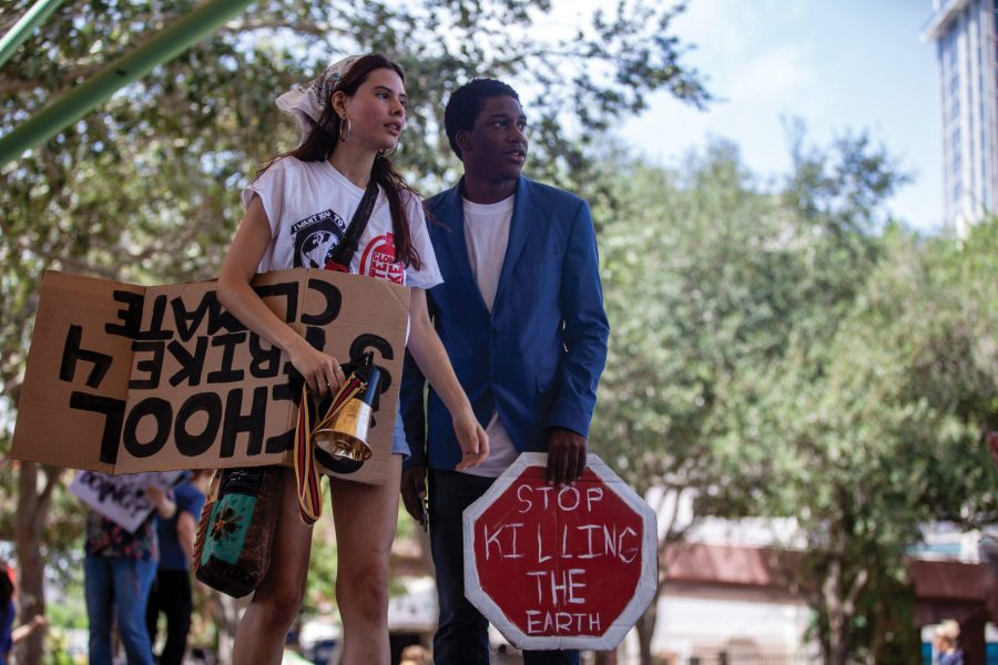 Searching for Change. Cypress Bay High School student activist Martina Velásquez and Broward County Human Relations Committee representative Elijah Manley oversee the Fort Lauderdale climate change protest, which they organized. Photo by Darian Williams