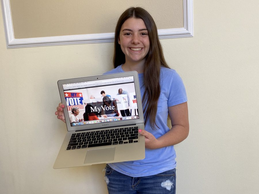 "Senior Sari Kaufman smiles with ""MyVote"