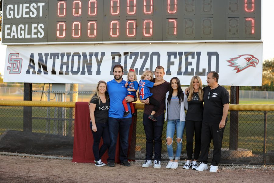 Anthony+Rizzo+stands+in+front+of+the+newly+named+Anthony+Rizzo+fields+at+Marjory+Stoneman+Douglas+High+School+on+Feb.+3%2C+2020.+Photo+courtesy+of+Jillian+Jarboe