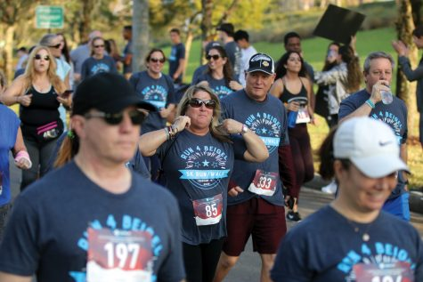 Math teacher Cindi Helverson honors the life of former MSD social studies teacher Scott Beigel at the third annual Run 4 Beigel 5K race on Saturday, Feb. 1. The race was held at Pine Trails Park in Parkland, Florida. Photo by Darian Williams