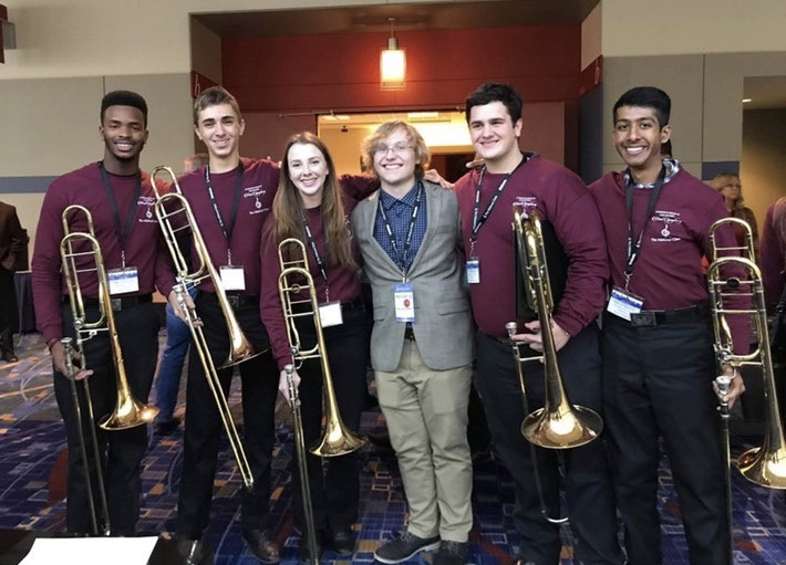 Frybergh (second from left), composer Harrison J. Collins and some members of MSD's trombone section are pictured at the Midwest Clinic in Chicago, Illinois. Photo courtesy of Hunter Frybergh