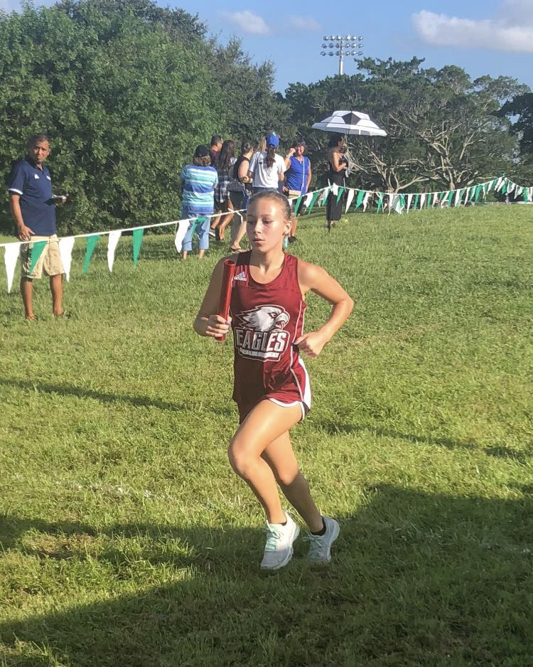 Greenwald is pictured running for MSD at one of her meets.